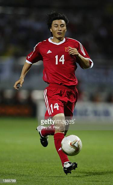 Weifeng Li of China charges forward during the FIFA World Cup Finals 2002 Group C match between Brazil and China played at the SeogwipoJeju World Cup...