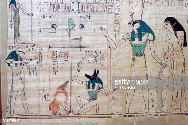 Weighing of the heart of the deceased against the feather of truth by Anubis Ammut waits to devour the heart if not justified Thoth on the left...