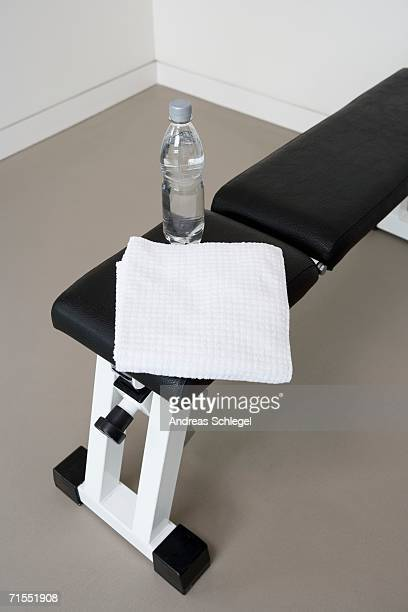 Weight bench with water bottle and towel