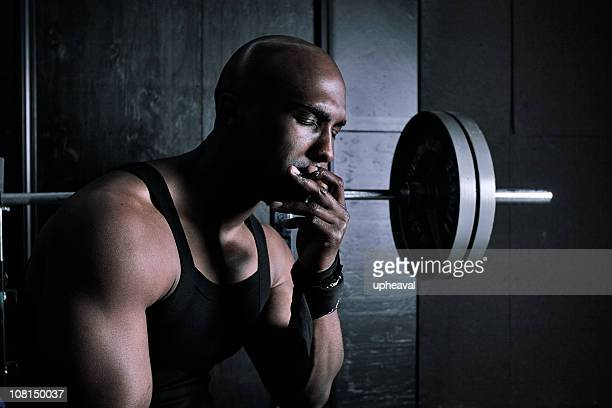 weight on my back - black male bodybuilders stock photos and pictures