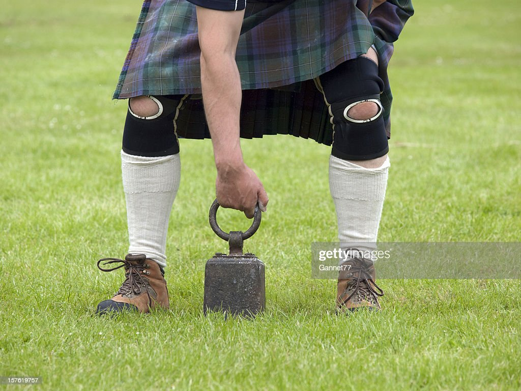 Weight over the bar - Highland Games : Stock Photo