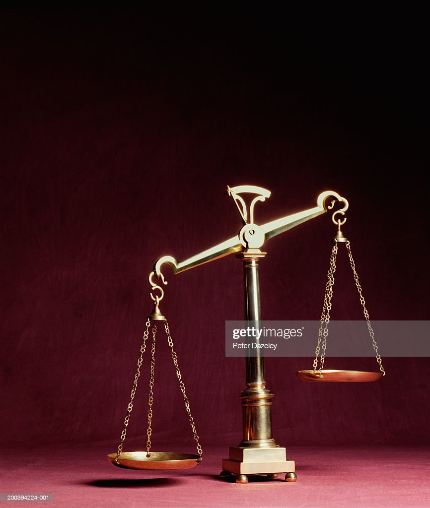 Weight scales tipped off balance : Stock Photo