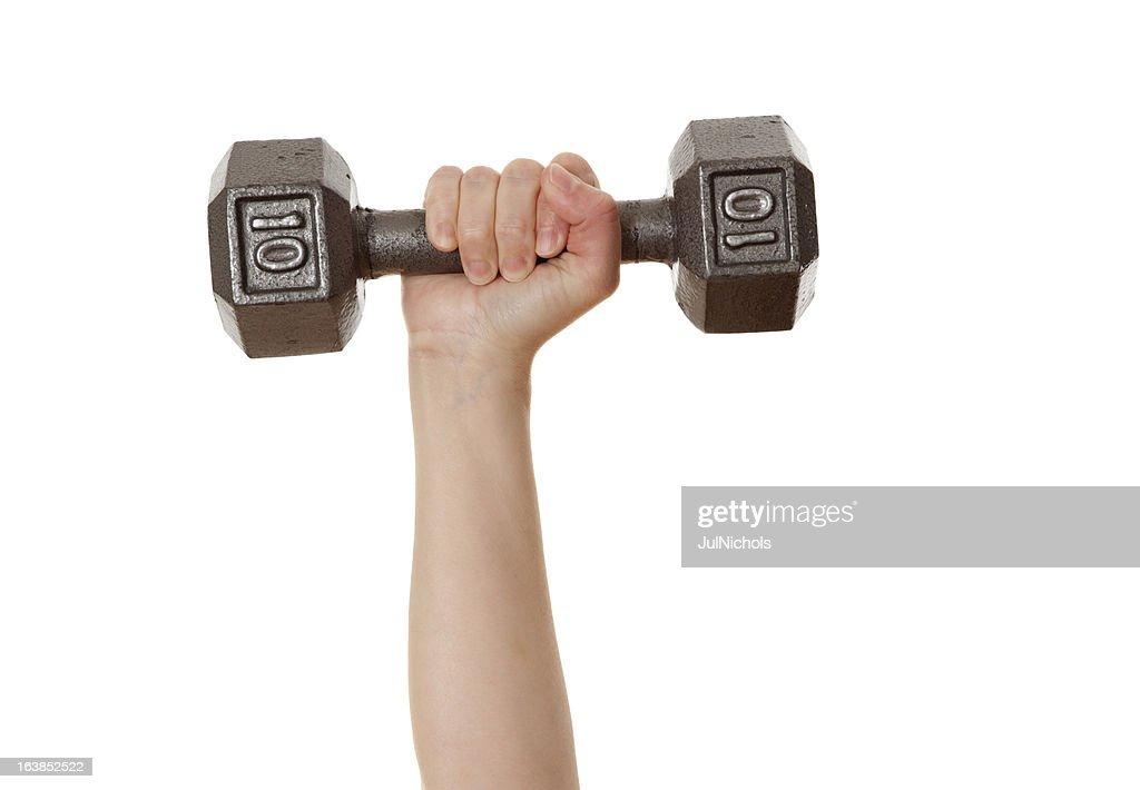 Treinamento de peso: Mulher levantando halteres : Foto de stock