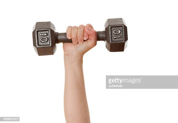 weight training: woman lifting dumbbell - weight stock pictures, royalty-free photos & images
