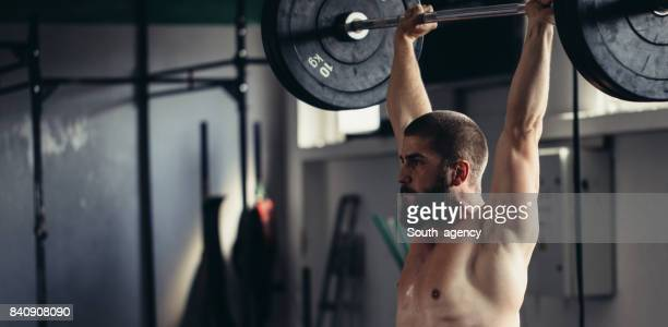 weightlifter training - snatch weightlifting stock photos and pictures