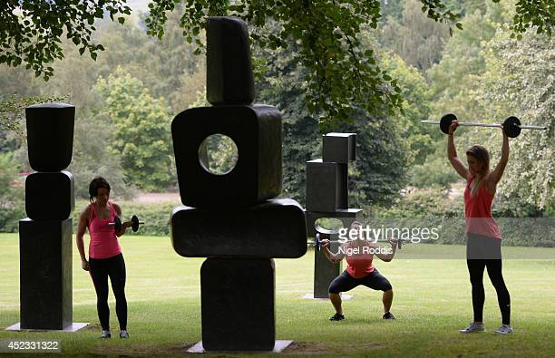 Weightlifters perform amongst sculptures as artist Helen Benigson presents an open air event for media at the Yorkshire Sculpture Park on July 18...