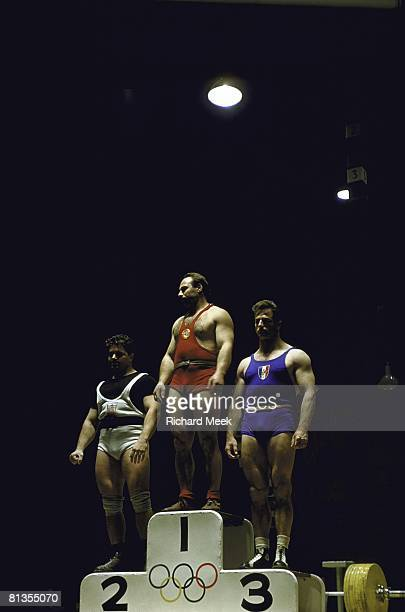 Weightlifting: 1956 Summer Olympics, USA David Sheppard, USR Arkhadiy Vorobyev, and FRA Jean Debuf victorious after 198 lb competition, Melbourne,...