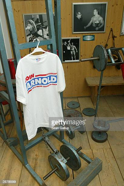 Weightlifting equipment from the original gym where Arnold Schwarzenegger first began training stand on display along with photographs and a...
