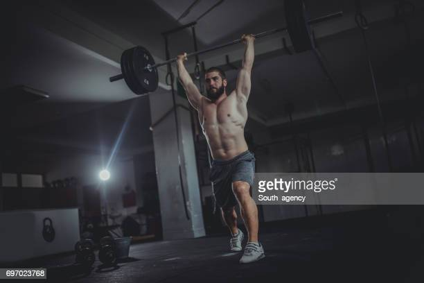 weightlifting exercise - snatch weightlifting stock photos and pictures