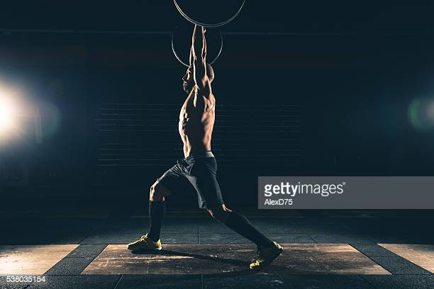weightlifting strong man on a gym - circuit training stock photos and pictures