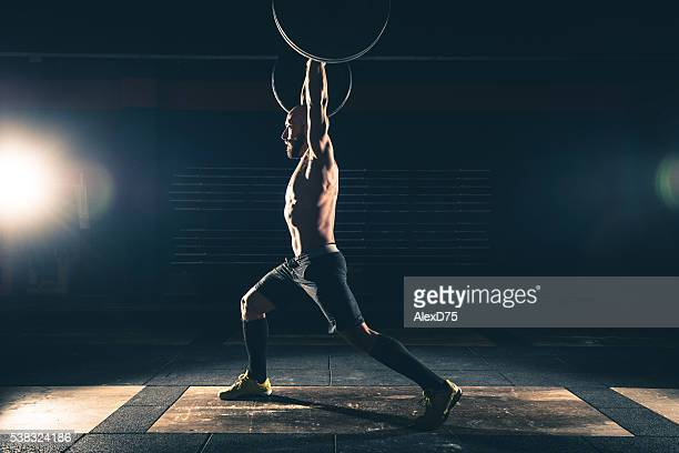 weightlifting strong man on a gym - weight stock pictures, royalty-free photos & images