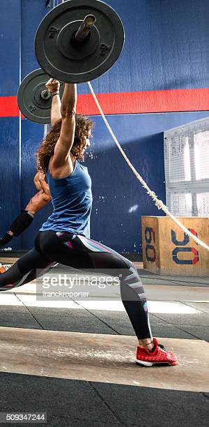 weightlifting strong woman on a gym - snatch weightlifting stock photos and pictures