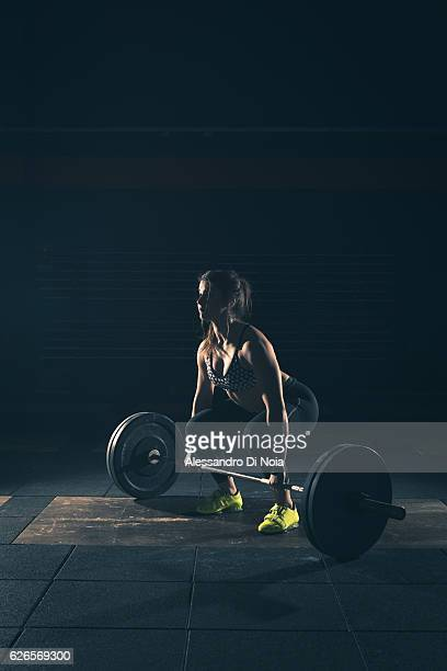 weightlifting strong woman on a gym