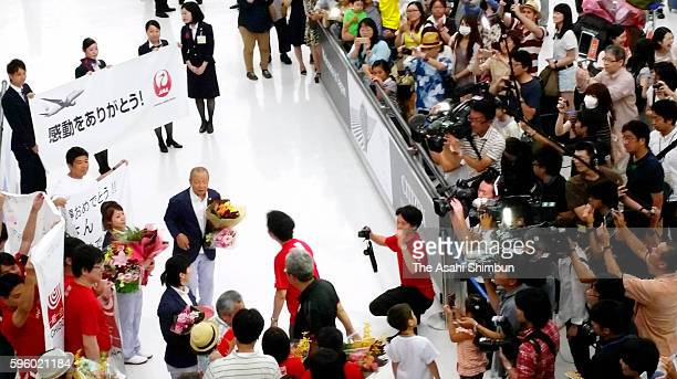 Weightlifting Women's 48kg Bronze Medalist Hiromi Miyake is welcomed by fans on arrival at Narita International Airport on August 14, 2016 in Narita,...