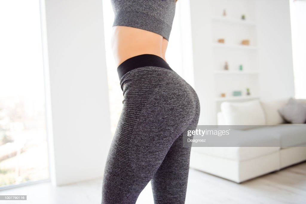 Weightloss wellness eating nutrition vitality concept. Cropped close up view photo of sexual sporty sportive tempting beautiful attractive nice round ass wearing gray tight pants leggings : Stock Photo