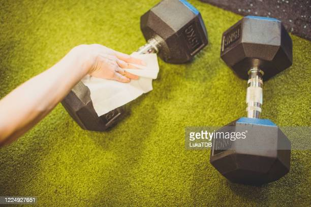 weights being cleaned - rubbing stock pictures, royalty-free photos & images