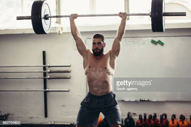 weights up - snatch weightlifting stock photos and pictures
