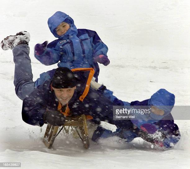 Gerhard Hildebrandt loses control of his daughters' Savannah and Alexandra while riding daddy horsey style down the toboggan hill at Etobicoke...