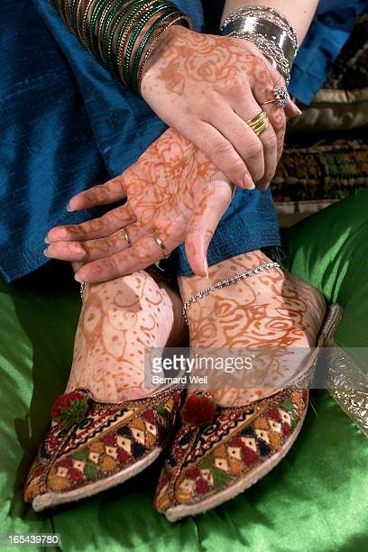 Nuzhat Haqqi models the henna and decorations on her hands and feestPix for story in gift guide on special gifts and fashion items for Eid which is...