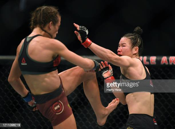Weili Zhang avoids a kick from Joanna Jedrzejczyk during her split decision win to retain her strawweight title at TMobile Arena on March 07 2020 in...