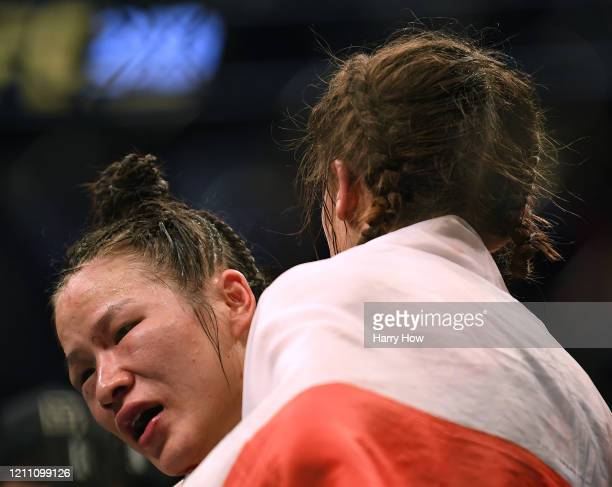 Weili Zhang hugs Joanna Jedrzejczyk during her split decision win to retain her strawweight title at TMobile Arena on March 07 2020 in Las Vegas...