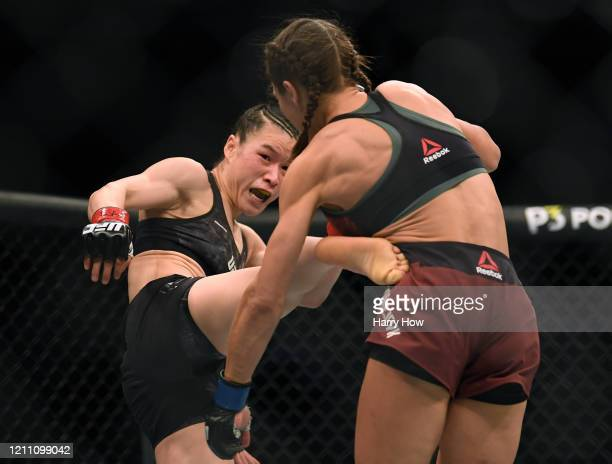 Weili Zhang kicks Joanna Jedrzejczyk during her split decision win to retain her strawweight title at TMobile Arena on March 07 2020 in Las Vegas...