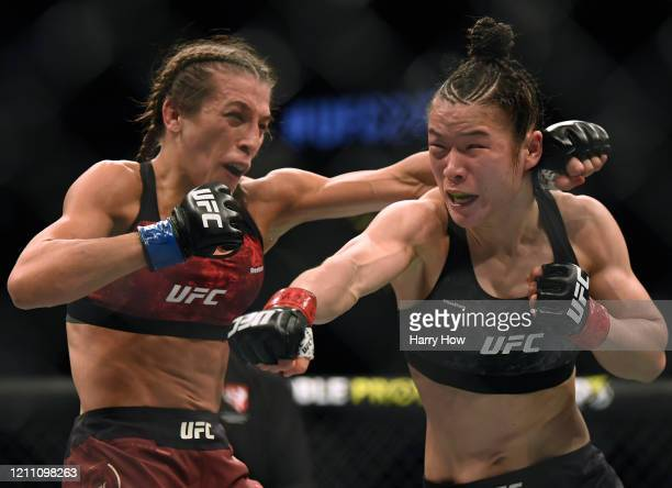 Weili Zhang punches Joanna Jedrzejczyk during her split decision win to retain her strawweight title at T-Mobile Arena on March 07, 2020 in Las...