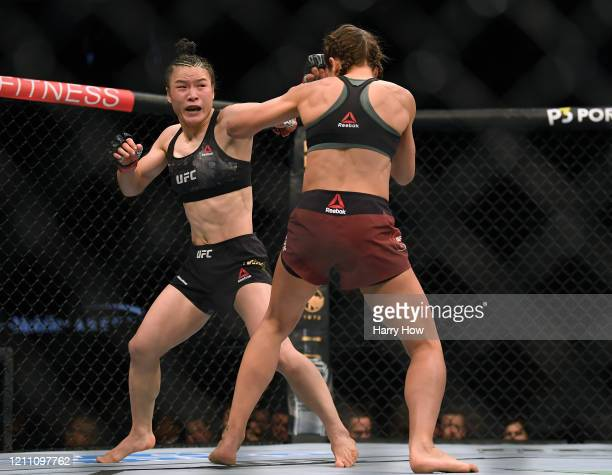 Weili Zhang punches Joanna Jedrzejczyk in her split decision win during a strawweight title bout at TMobile Arena on March 07 2020 in Las Vegas Nevada