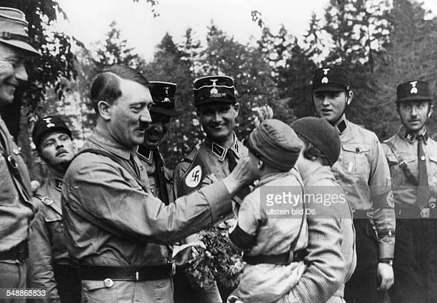 Weimar Rebublic Harzburg Front Meeting of right wing 'national opposition' in Bad Harzburg Adolf Hilter receives a flower bouquet from a young boy in...