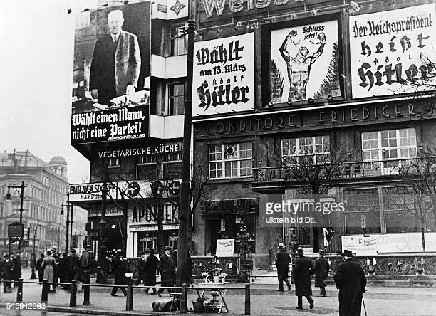 Weimar Republic Presidential elections 1932 Election posters for the candidates Hindenburg and Hitler Berlin Potsdamer Platz early in march 1932
