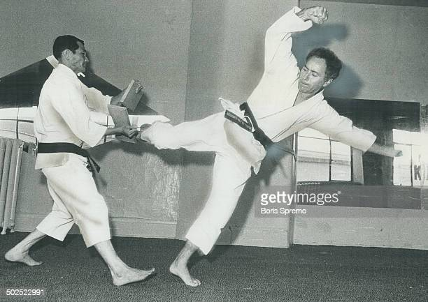 Weingust; 42; uses his foot to break piece of wood held by karate instructor Kyong Lee. The Toronto lawyer took up karate when he was 39 and in three...
