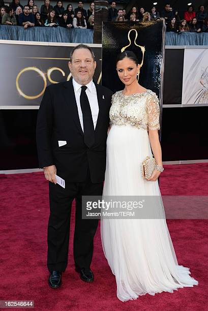 Weinstein Company CoChairman Harvey Weinstein and designer Georgina Chapman arrive at the Oscars at Hollywood Highland Center on February 24 2013 in...