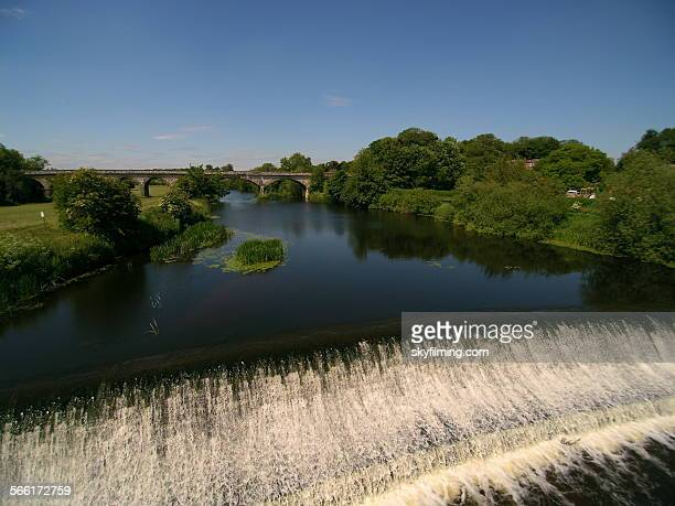 weir on river wharf - tadcaster stock photos and pictures