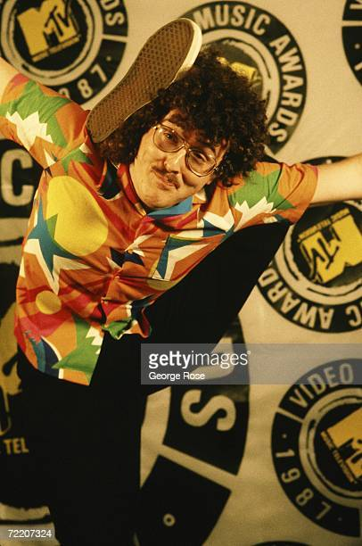 Weird Al Yankovic poses on the red carpet with his foot behind his head at the 1987 MTV Music Awards held in Universal City California Yankovic made...