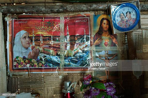 A weird mix a Muslim and Christian images posted in a Shan State village house