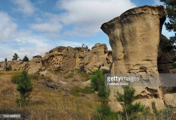 weirdly eroded rock formations at medicine rocks state park - state stock pictures, royalty-free photos & images
