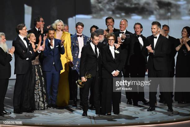 D B Weiss and Bernadette Caulfield with cast and crew accept award for Outstanding Drama Series 'Game of Thrones' onstage during the 70th Emmy Awards...