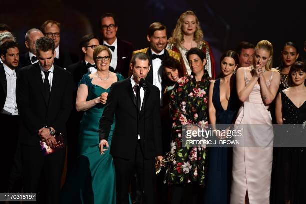 """Weiss and cast and crew of """"Game of Thrones"""" accept the Outstanding Drama Series award onstage during the 71st Emmy Awards at the Microsoft Theatre..."""
