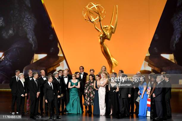 "Weiss and cast and crew of ""Game of Thrones"" accept the Outstanding Drama Series award onstage during the 71st Emmy Awards at Microsoft Theater on..."