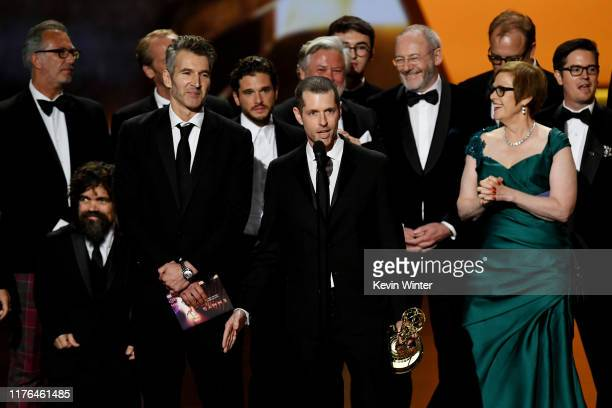 D B Weiss David Benioff and cast and crew of 'Game of Thrones' accept the Outstanding Drama Series award onstage during the 71st Emmy Awards at...