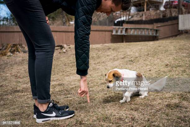 Weiss tries to get her dog Duck to sit in the backyard of her Bayside home Sunday April 1 2018 Weiss and her partner Laura Kloosterman rescued Duck...