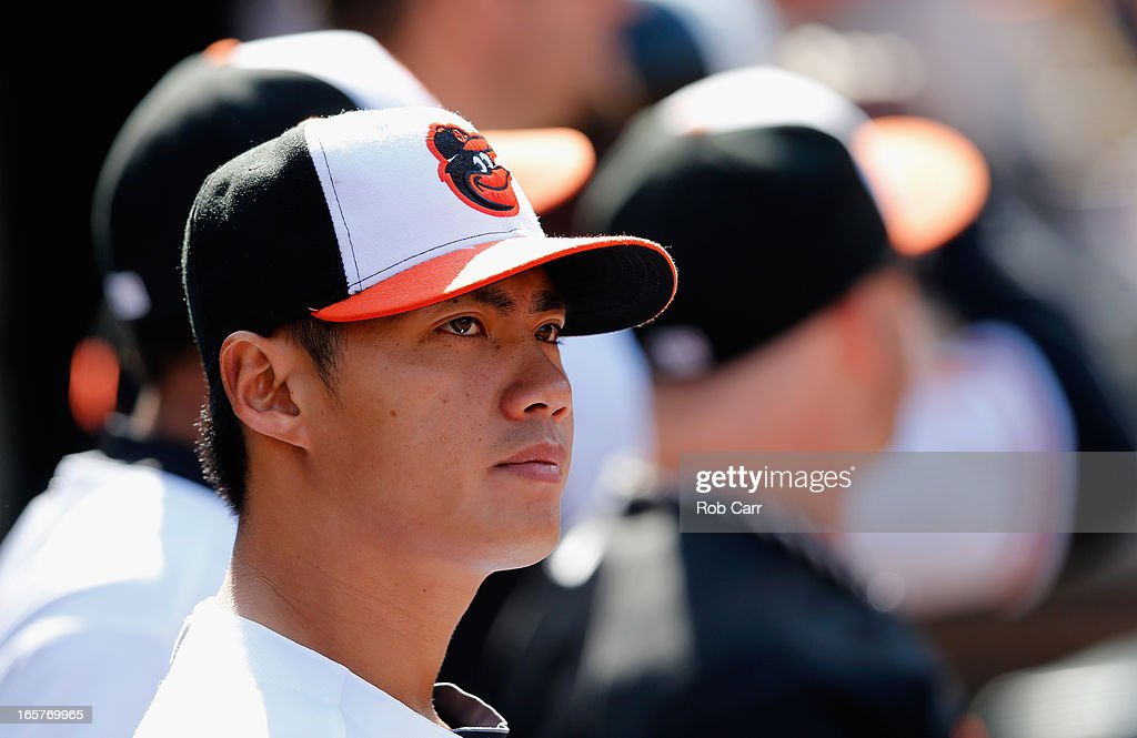 Wei-Yin Chen #16 of the Baltimore Orioles looks on from the dugout during the Orioles opening day game against the Minnesota Twins at Oriole Park at Camden Yards on April 5, 2013 in Baltimore, Maryland.