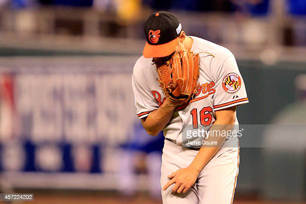 Wei-Yin Chen of the Baltimore Orioles reacts after Alex Gordon of the Kansas City Royals hit a grounder out to second base in the fourth inning to...