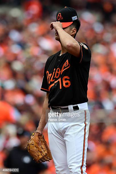 Wei-Yin Chen of the Baltimore Orioles reacts after J.D. Martinez of the Detroit Tigers hit a three run home run scoring Miguel Cabrera and Victor...