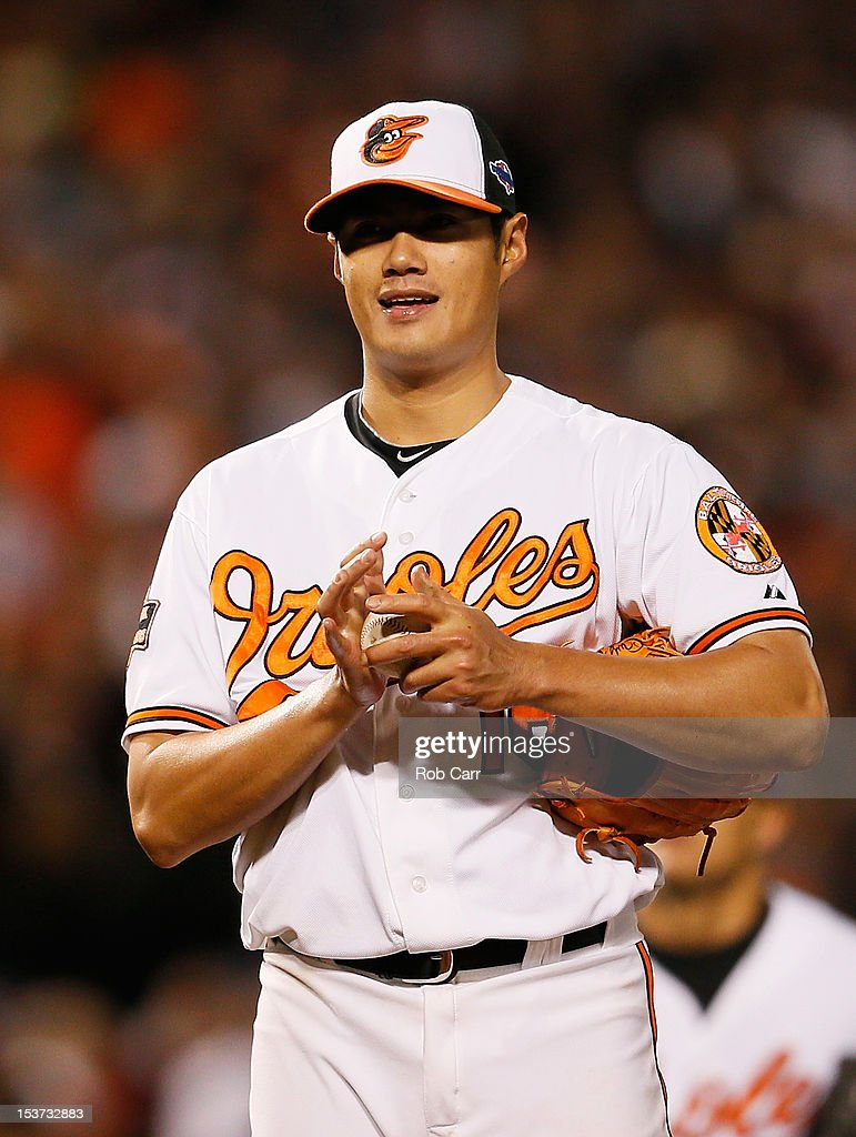Wei-Yin Chen #16 of the Baltimore Orioles reacts as he is relieved in the seventh inning during Game Two of the American League Division Series against the New York Yankees at Oriole Park at Camden Yards on October 8, 2012 in Baltimore, Maryland.