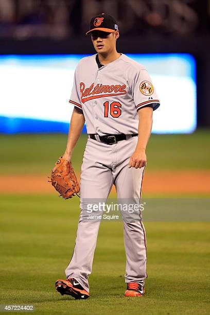 Wei-Yin Chen of the Baltimore Orioles walks back to back to the dugout in the third inning against the Kansas City Royals during Game Three of the...