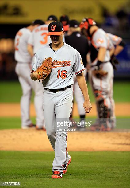 Wei-Yin Chen of the Baltimore Orioles walks back to the dugout after being relieved in the sixth inning against the Kansas City Royals during Game...
