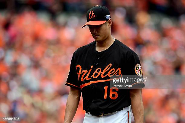 Wei-Yin Chen of the Baltimore Orioles walks to the dugout after being relieved in the fourth inning against the Detroit Tigers during Game Two of the...