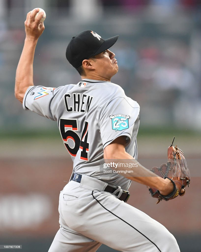 Wei-Yin Chen #54 of the Miami Marlins throws a first inning pitch against the Atlanta Braves at SunTrust Park on July 30, 2018 in Atlanta, Georgia.