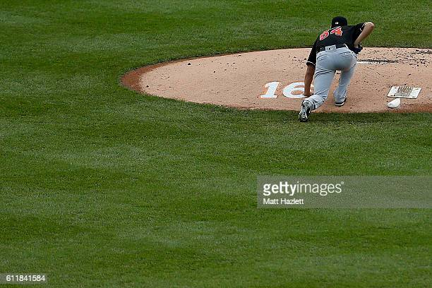 Wei-Yin Chen of the Miami Marlins touches a number 16 memorializing Miami Marlins pitcher Jose Fernandez, who died in a boating accident, on the...